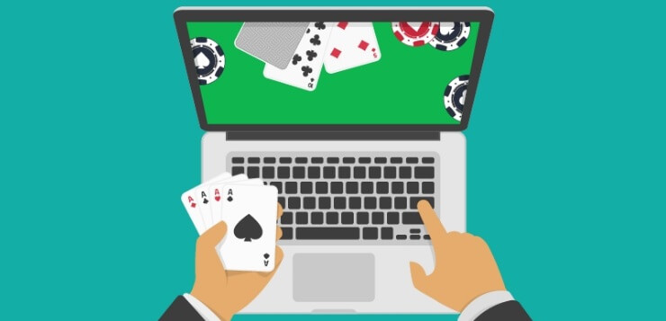 playing online poker on laptop
